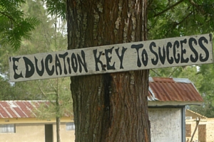 "Sign on a tree saying ""Education key to success"""