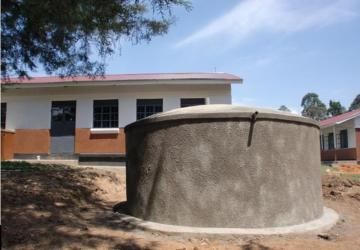 Rainwater collection tank at Nyabiteete