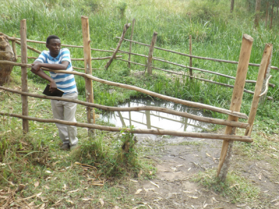 Marius demonstrates the need for sustainability next to a muddy spring
