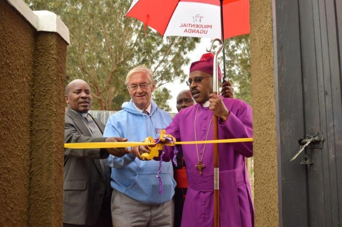 Ian Bensted, Bishop Benon Magezi and Eric Baingana cut the ribbon at Rumbugu