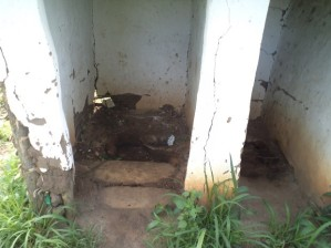 A filthy, crumbling latrine at Bwambara