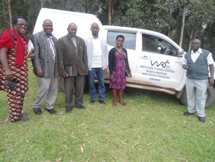 WATSAN staff standing next to the new vehicle
